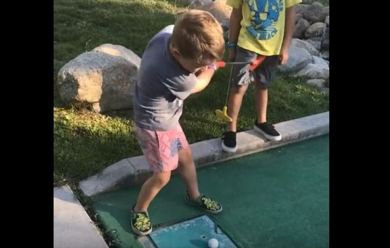 kid-hits-brother-in-nuts-while-miniature-golfing-4_r