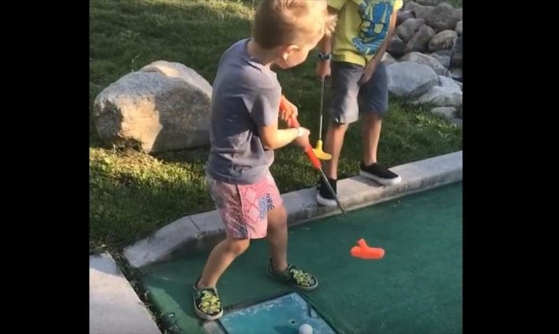 kid-hits-brother-in-nuts-while-miniature-golfing-5_r