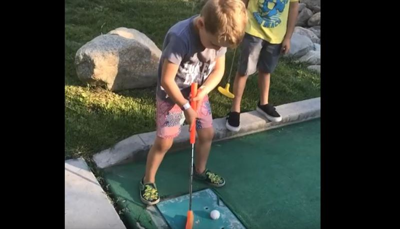 kid-hits-brother-in-nuts-while-miniature-golfing_r